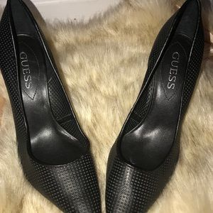 Black leather pointed toed heels